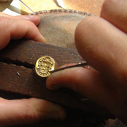 An engraver working by hand