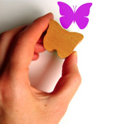A homemade rubber stamp in the shape of a butterfly